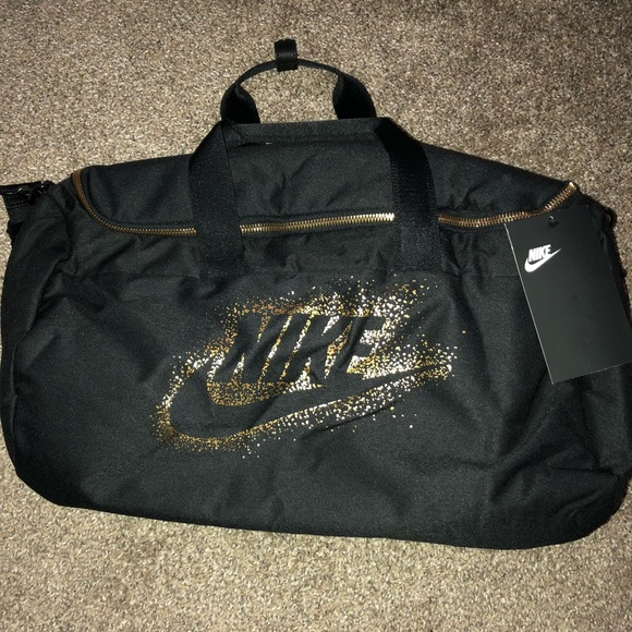 f16fe5212376 WOMENS NIKE METALLIC DUFFLE BAG